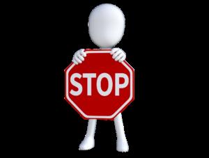 """Ludzik trzymajacy znak """"stop"""""""